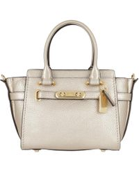 COACH - Swagger 21 Pebbled Leather Shoulder Bag Light Gold/platinum - Lyst
