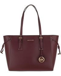 Michael Kors - Voyager Md Multifunctional Tz Tote Oxblood - Lyst