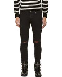 Saint Laurent Black Ripped_knee Slim Jeans - Lyst