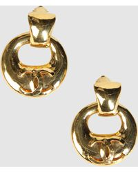 Chanel Earrings gold - Lyst