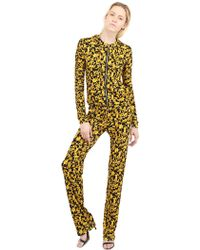 Versace Printed Viscose Jersey Pants - Lyst