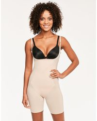 Spanx - Thinstincts Open-bust Mid-thigh Bodysuit - Lyst
