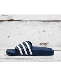 35ecbc61648170 Lyst - Women s adidas Originals Flip-flops On Sale
