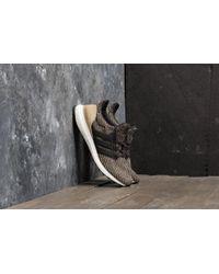 4d2b64987 Footshop - Adidas Ultraboost Core Black  Core Black  Raw Gold - Lyst