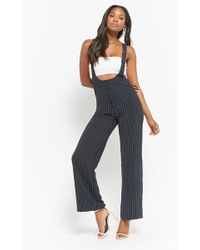 34a1038ba642 Lyst - Forever 21 Plus Size Pinstriped Jumpsuit in Black