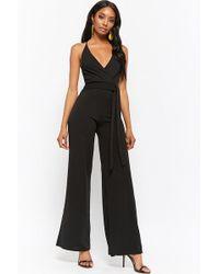 29399ffefd1 Lyst - Forever 21 Wide-leg Surplice Jumpsuit in Black