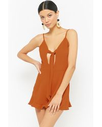 d1cf50917bfc Lyst - Forever 21 Bejeweled Chiffon Surplice Romper in Green