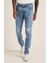 Forever 21 - Distressed Knee Skinny Jeans - Lyst