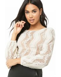 6cda3f168c412d Lyst - Forever 21 Semi-sheer Lace Crop Top in White