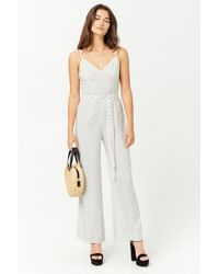 265143b389ab1b Forever 21 - Women s Semi-sheer Diamond-dotted Jumpsuit - Lyst