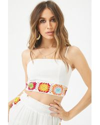 9c4be3a1a660c Lyst - Forever 21 Floral Eyelet Lace-up Crop Top in White