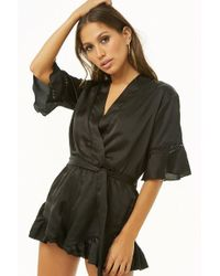 08331d8d44a Lyst - Forever 21 Lush Flounce Halter Romper in Brown