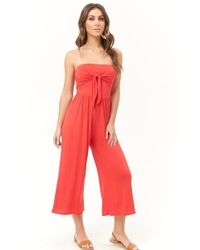 1f1b94684dcf Forever 21 Strapless Pleated Jumpsuit in Red - Lyst