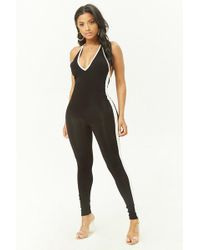 b308b07a885 Lyst - Forever 21 Striped Halter Jumpsuit in Black
