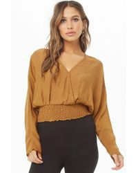 c4cd55a9537610 Lyst - Forever 21 Smocked Flounce Crop Top