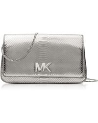22e4c2e5a6c3 Michael Kors - Mott Large Silver Metallic Ayers Embossed Leather Clutch -  Lyst