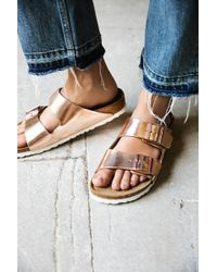 84526ace71e63 Lyst - Free People Arizona Washed Metallic Birkenstock Sandal in ...