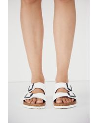 9641456f442ec Lyst - Free People Arizona Metallic-Leather Birkenstocks in Blue
