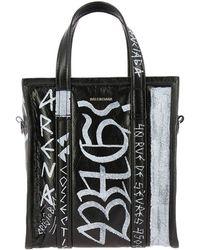 104801316b Balenciaga - Borsa bazar graffiti shopping xs in vera pelle con maxi stampe  all over e