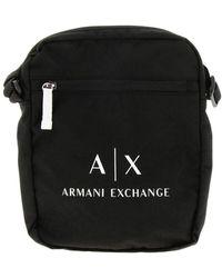 96c16510c514a Schwarze Nylon-Pilotentasche mit Logomuster. 95 €. ASOS · Armani Exchange -  Tasche für Herren - Lyst