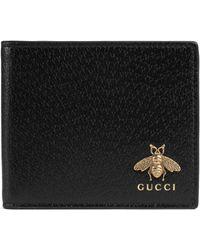 Gucci - Animalier Brieftasche aus Leder - Lyst