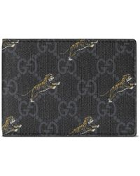787d0d628cf Lyst - Gucci Tiger Embossed Wallet in Black for Men