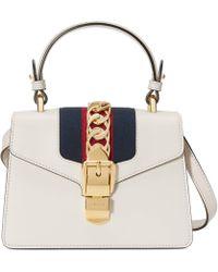 7330d32bb90ffa Gucci Sylvie Animal Studs Leather Mini Bag in White - Lyst
