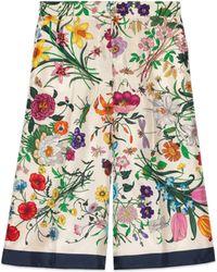 Gucci - Pantalone in twill di seta con stampa Flora - Lyst