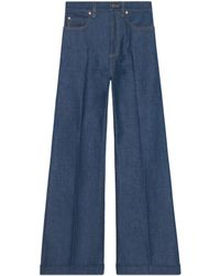 Gucci - Washed Denim Flare Trousers - Lyst