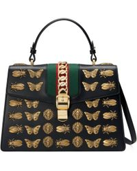 c4d6577b6d7 Gucci - Sylvie Animal Studs Leather Top Handle Bag - Lyst