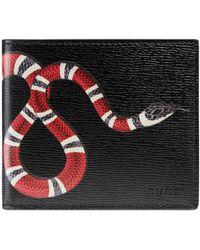 Gucci - Portafoglio in pelle con stampa serpente - Lyst
