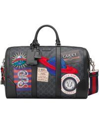 Gucci - Borsa da viaggio Night Courrier in GG Supreme - Lyst