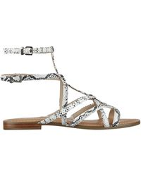 37f584c3d5d1 Lyst - Guess Mannie Women Us 5 Gold Gladiator Sandal in Metallic