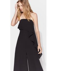 Halston - Strapless Jumpsuit With Flounce Overlay - Lyst