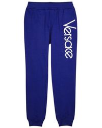 Versace - Logo-embroidered Cotton Jogging Trousers - Lyst