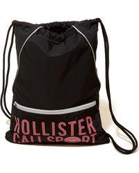 Hollister - Graphic Nylon Drawstring Bag - Lyst