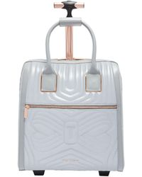 Ted Baker - Reflective Quilted Bow Travel Bag - Lyst