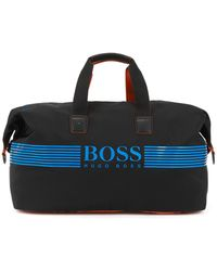 BOSS - Holdall With Rubberized Logo And Zippered Shoe Compartment - Lyst