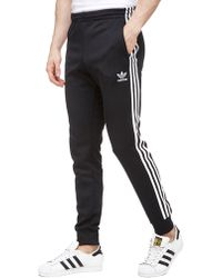 adidas Originals - Superstar Cuffed Track Trousers - Lyst