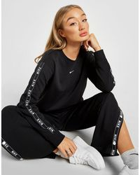 aca4a8a9e9885 Lyst - Nike Cropped Crew Neck Swish Sweatshirt in Black