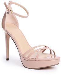 75a100ef92f Guess - Cassy Strappy Platform Heels - Lyst