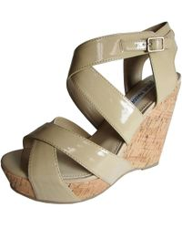 ce4a52a622b8 Lyst - BCBGMAXAZRIA Dame Color Block Leather Wedge Sandal