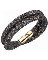 Swarovski - Gold-tone Black Stardust Wrap Bracelet - Lyst