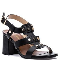 2e06a402c2f77 Tory Burch Cecile Black Leather Heel Sandal in Black - Lyst