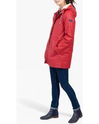 2576793e98d4 Joules Golightly Pack-away Waterproof Spot Print Parka Coat in Blue ...