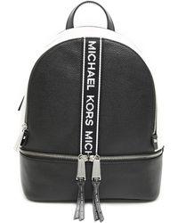 5bc72671949a MICHAEL Michael Kors - Michael Kors Rhea Medium Logo Band Backpack - Lyst