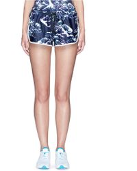 We Are Handsome - 'the Cascade' Tidal Wave Print Active Running Shorts - Lyst