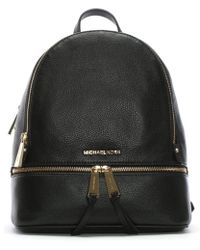 163cfc5fc781 Lyst - Michael Kors Lace Embossed Rhea Black Leather Backpack in Black