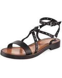 2e5344726009 Lyst - Valentino Rockstud Crisscross Flat Sandal in Black