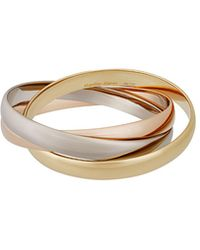Cartier - Estate Trinity De 18k Gold Classic Triple-band Bangle - Lyst